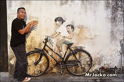 street-art-penang-kids-bicycle